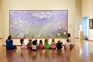 children-in-museum-raising-hands